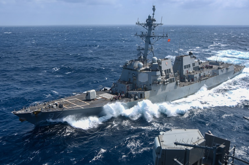 The guided-missile destroyer USS Halsey (DDG 97) approaches the aircraft carrier USS Ronald Reagan (CVN 76), not pictured, in preparation for a fueling-at-sea.