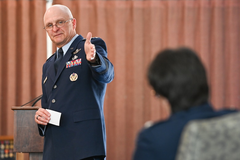 Gen. Arnold W. Bunch Jr., commander, Air Force Materiel Command, congratulates Col. Amanda G. Kato during the retirement ceremony honoring her more than 29 years of service in the Air Force on June 18, 2021, at Hanscom Air Force Base, Massachusetts. (U.S. Air Force photo by Todd Maki)