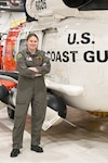 Lt. Amanda Thrasher, a Coast Guard search and rescue pilot, stands in the helicopter hangar at Coast Guard Air Station Astoria, at Sector Columbia River, in Warrenton, Oregon, Monday, June 21, 2021. Thrasher serves in the mountainous coastal terrain of the Pacific Northwest where she strives every day to infuse positive impact on personnel who serve in the country's premier life-saving service. U.S. Coast Guard photo by Petty Officer 1st Class Cynthia Oldham.