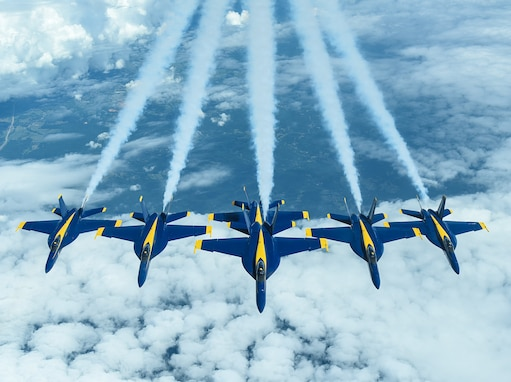 Six U.S. Navy Blue Angels F/A-18 Hornets fly in formation behind a KC-10 Extender assigned to the 305th Air Mobility Wing on Joint Base McGuire-Dix-Lakehurst, N.J., June 28, 2021.