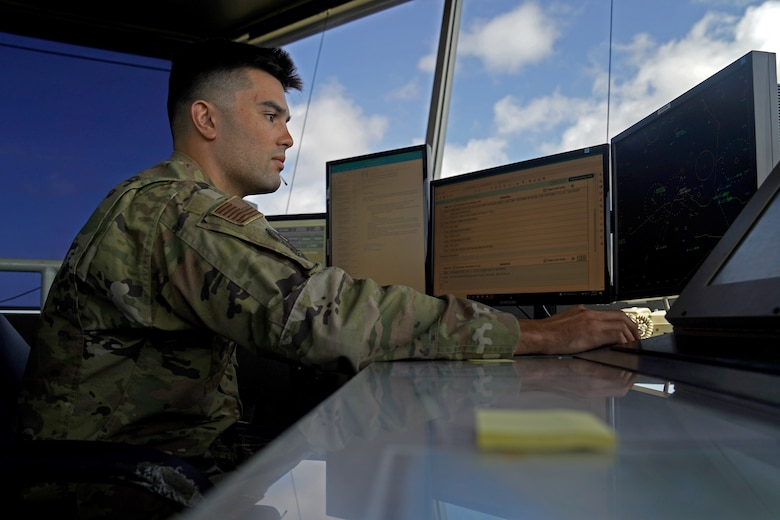 U.S. Air Force Staff Sgt. Brandon Ahuna, 81st Training Wing Operations Support Flight tower watch supervisor, works on his computer inside the Keesler Air Traffic Control tower at Keesler Air Force Base, Mississippi, June 25, 2021. The 81st TRW OSF traffics the aircraft on the Keesler flightline and the local airspace. (U.S. Air Force photo by Senior Airman Seth Haddix)