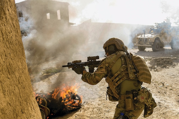 A U.S. Special Operations soldier returns fire while conducting multi-day Afghan-led offensive operations against the Taliban in Mohammad Agha district, Logar Province, Afghanistan, July 28, 2018. (U.S. Air Force photo by Staff Sgt. Nicholas Byers)