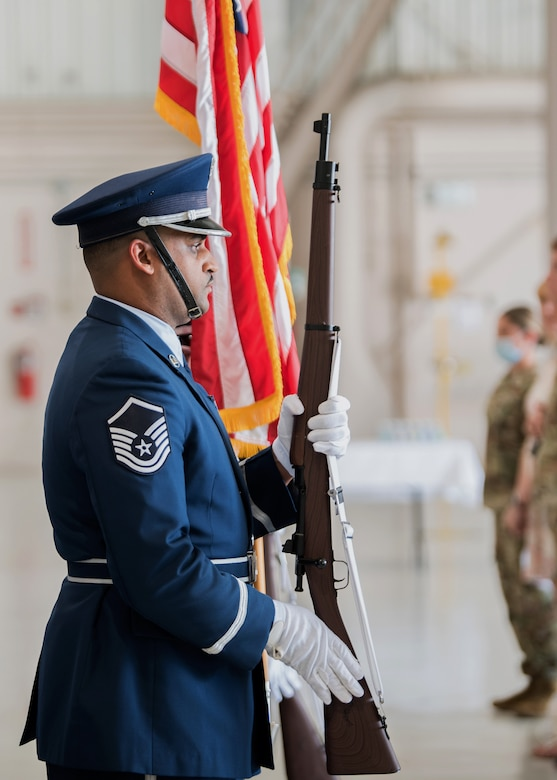 Master Sgt. Jason Newby, a member of the 123rd Airlift Wing's Base Honor Guard, stands at attention for the playing of the National Anthem during a ceremony at the Kentucky Air National Guard Base in Louisville, Ky., May 15, 2021. Chief Master Sgt. James Tongate assumed responsibility as the newest state command chief during the ceremony. (U.S. Air National Guard photo by Senior Airman Chloe Ochs)