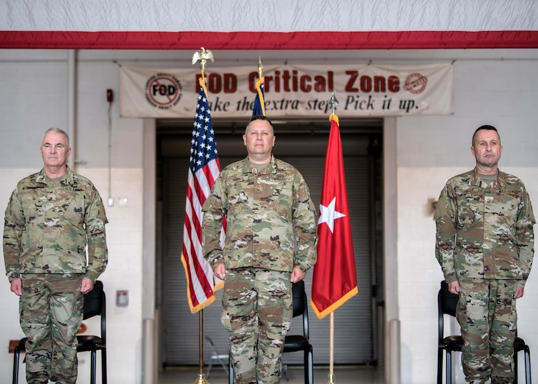 Chief Master Sgt. James Tongate (center), incoming state command chief of the Kentucky Air National Guard, stands at attention to accept his new role alongside Brig. Gen. Hal Lamberton (left), the adjutant general of Kentucky, and Chief Master Sgt. Ray Dawson (right), outgoing state command chief, during a ceremony at the Kentucky Air National Guard Base in Louisville, Ky., May 15, 2021. Tongate previously served as the 123rd Airlift Wing's human resource advisor. (U.S. Air National Guard photo by Senior Airman Chloe Ochs)