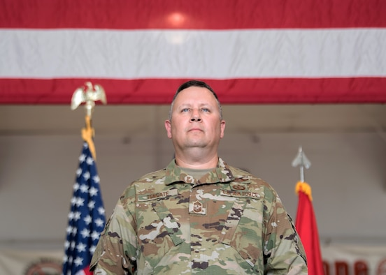 Chief Master Sgt. James Tongate stands at attention to accept his new role as state command chief of the Kentucky Air National Guard during a ceremony at the Kentucky Air National Guard Base in Louisville, Ky., May 15, 2021. Tongate previously served as human resource advisor for the 123rd Airlift Wing. (U.S. Air National Guard photo by Senior Airman Chloe Ochs)