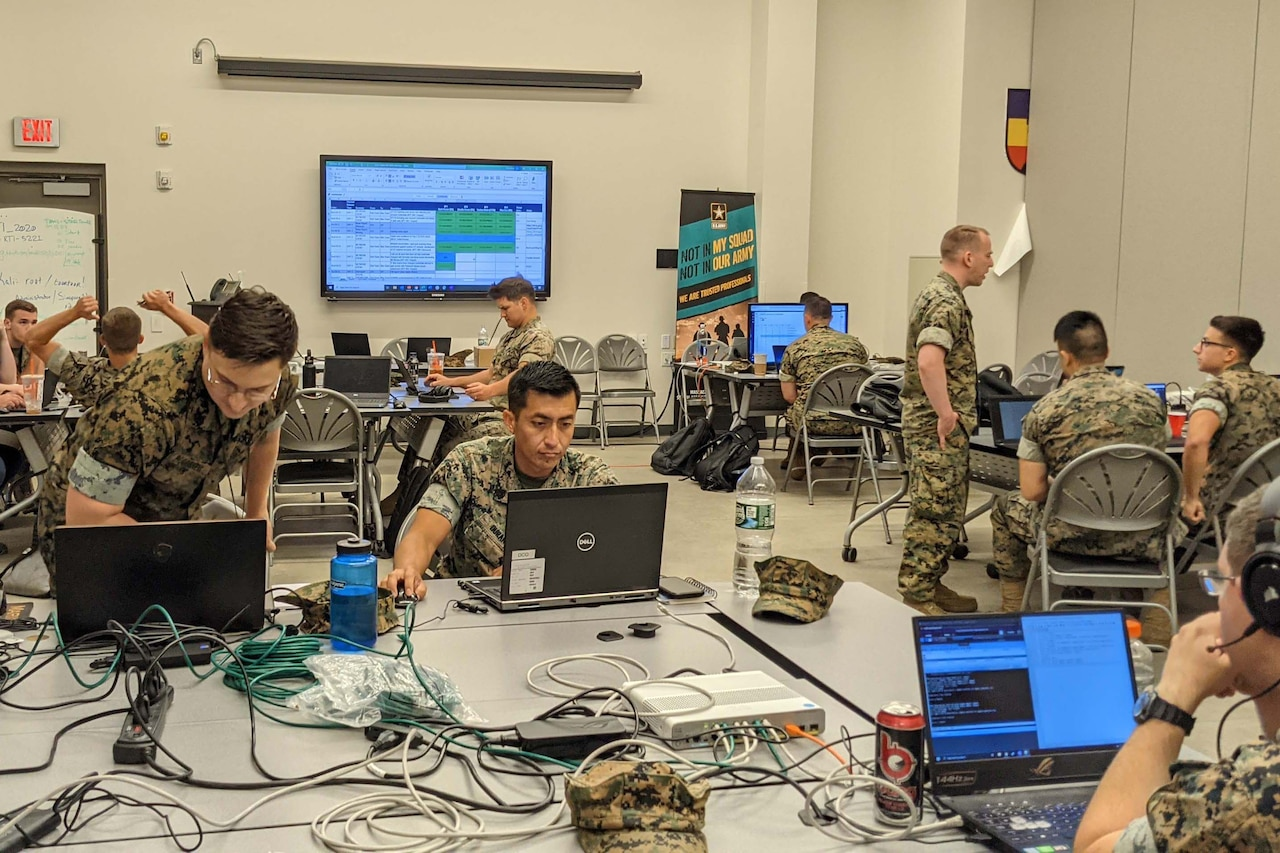 Marines operate laptops.