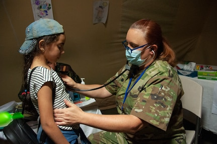U.S. Air Force Lt. Col. Nicole Christiano, a physician with the 146th Airlift Wing, examines a pediatric patient at the Military Medical Surgical Field Hospital in Tafraoute, Morocco on June 13, 2021 during African Lion 2021.