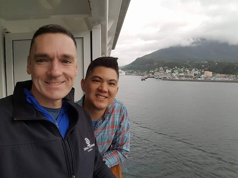 Two men smile while on a boat.
