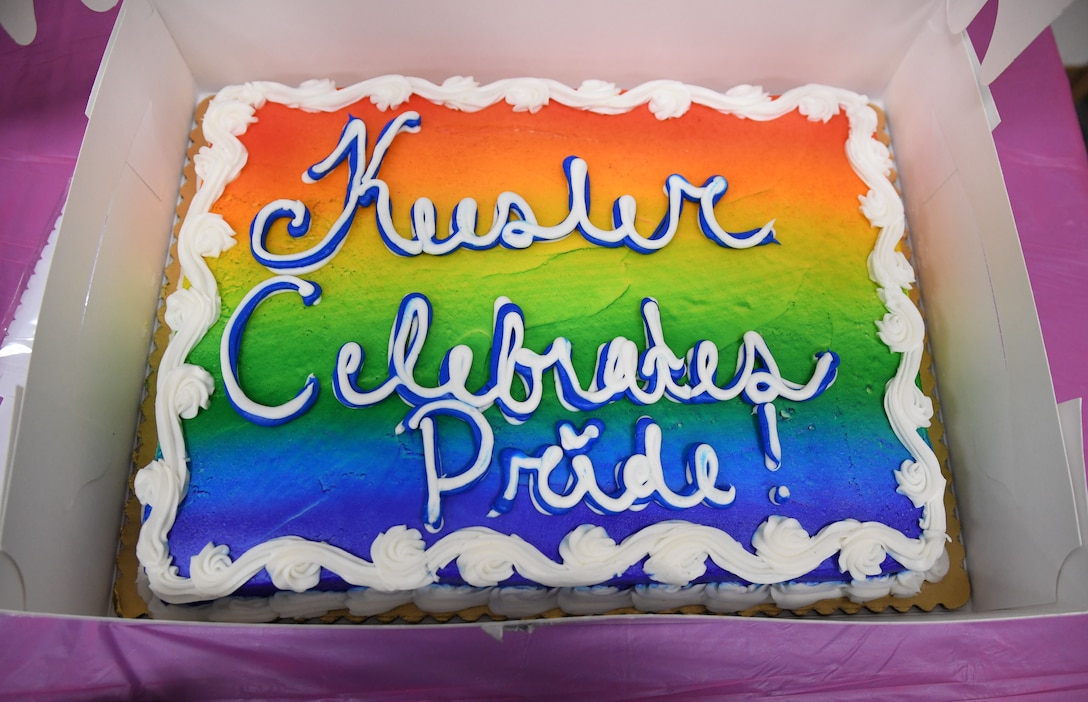 A cake is on display during the LGBTQ+ Informational Expo inside the Roberts Consolidated Aircraft Maintenance Facility at Keesler Air Force Base, Mississippi, June 25, 2021. Keesler celebrated Pride Month throughout June, with events such as a scavenger hunt, guest speaker and discussion panel. (U.S. Air Force photo by Kemberly Groue)