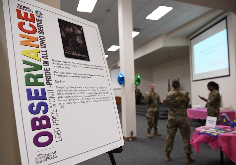 A poster is on display during the LGBTQ+ Informational Expo inside the Roberts Consolidated Aircraft Maintenance Facility at Keesler Air Force Base, Mississippi, June 25, 2021. Keesler celebrated Pride Month throughout June, with events such as a scavenger hunt, guest speaker and discussion panel. (U.S. Air Force photo by Kemberly Groue)