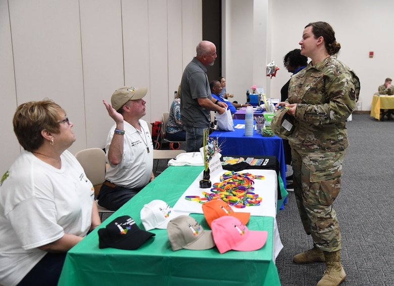 Keesler personnel attend the LGBTQ+ Informational Expo inside the Roberts Consolidated Aircraft Maintenance Facility at Keesler Air Force Base, Mississippi, June 25, 2021. Keesler celebrated Pride Month throughout June, with events such as a scavenger hunt, guest speaker and discussion panel. (U.S. Air Force photo by Kemberly Groue)