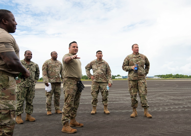 U.S. Air Force Master Sgt. Lynn Stephan, an air advisor from the 36th Contingency Response Support Squadron, briefs U.S. Air Force Col. R Schmidt, 36th Contingency Response Group commander, on the Palau National Airport, June 23, 2021. A Mobile Training Team of subject matter experts from Andersen AFB went to teach members from the Ministry of Justice and Ministry of Public Infrastructure and Institution in Palau how to properly utilize equipment they received from the Department of Defense. (U.S. Air Force photo by Senior Airman Aubree Owens)