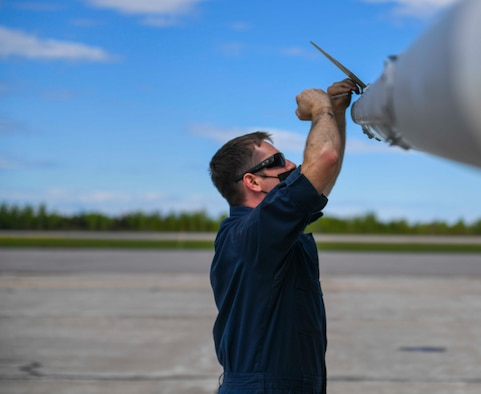 A U.S. Air Force Airman from the 140th Aircraft Maintenance Squadron removes weapons from an F-16 Fighting Falcon during exercise Amalgam Dart 21-01 in Goose Bay, Canada, June 14, 2021. Exercise Amalgam Dart will run from June 10-19, 2021, with operations ranging across the Arctic from the Beaufort Sea to Thule, Greenland. Amalgam Dart 21-01 provides NORAD the opportunity to hone continental defense skills as Canadian and U.S. forces operate together in the Arctic. A bi-national Canadian and American command, NORAD employs a network of space-based, aerial and ground-based sensors, air-to-air refueling tankers, and fighter aircraft, controlled by a sophisticated command and control network to deter, deny and defeat aerospace threats that originate outside or within our borders. (U.S. Air Force photo by Airman 1st Class Kiaundra Miller)
