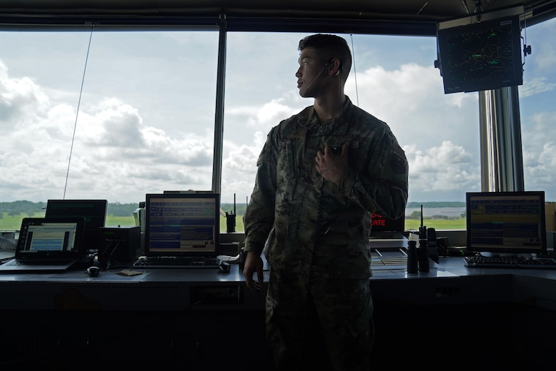 U.S. Air Force Airman 1st Class Jacob Penny, 81st Training Wing air traffic controller, poses for a photo inside the Keesler Air Traffic Control tower at Keesler Air Force Base, Mississippi, June 25, 2021. The 81st TRW Operations Support Flight traffics the aircraft on the Keesler flightline and the local airspace. (U.S. Air Force photo by Senior Airman Seth Haddix)