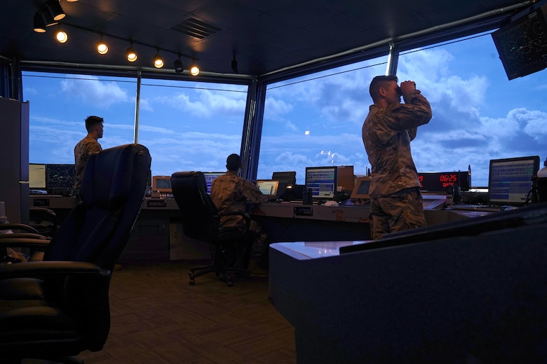 U.S. Air Force Staff Sgt. Brandon Ahuna, 81st Training Wing Operations Support Flight tower watch supervisor, Senior Airman Marcus Hamilton, 81st TRW air traffic control trainer, Airman 1st Class Jacob Penny, 81st TRW air traffic controller, work inside the Keesler Air Traffic Control tower at Keesler Air Force Base, Mississippi, June 25, 2021. The 81st TRW OSF traffics the aircraft on the Keesler flightline and the local airspace. (U.S. Air Force photo by Senior Airman Seth Haddix)