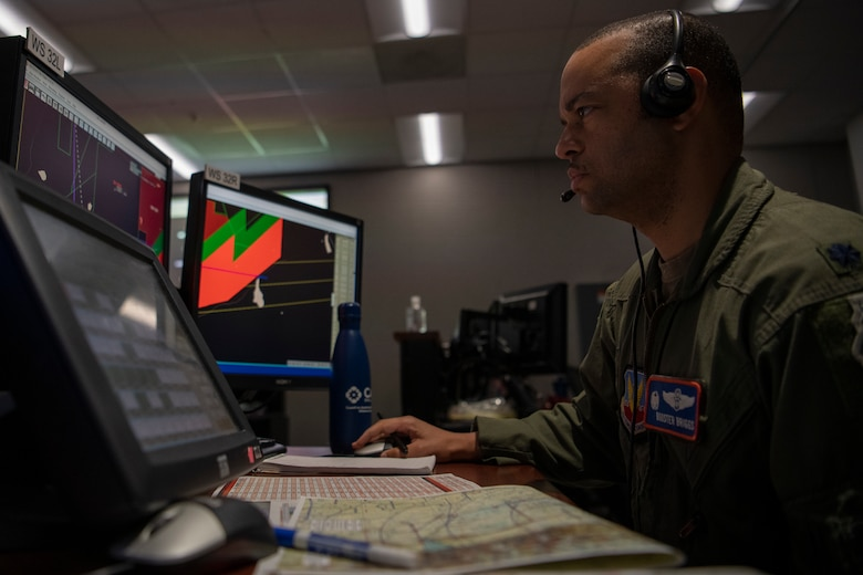 Airman works at computer in control room