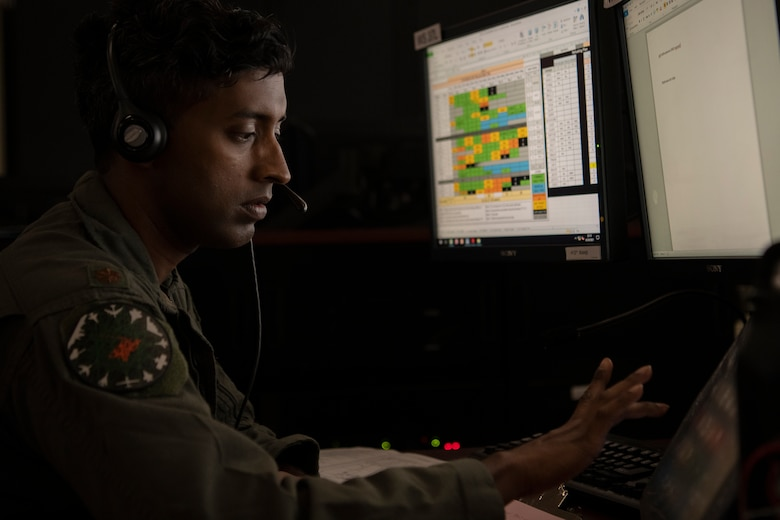 Airman works on computer in control room