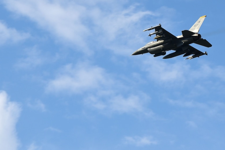 An F-16 Fighting Falcon flies over Eielson Air Force Base, Alaska during Red Flag-Alaska 21-2 at Eielson AFB, Alaska, June 17, 2032. RF-A reinforces the United States' continued commitment to the region as a Pacific nation, leader and power. (U.S. Air Force photo by Senior Airman Suzie Plotnikov)