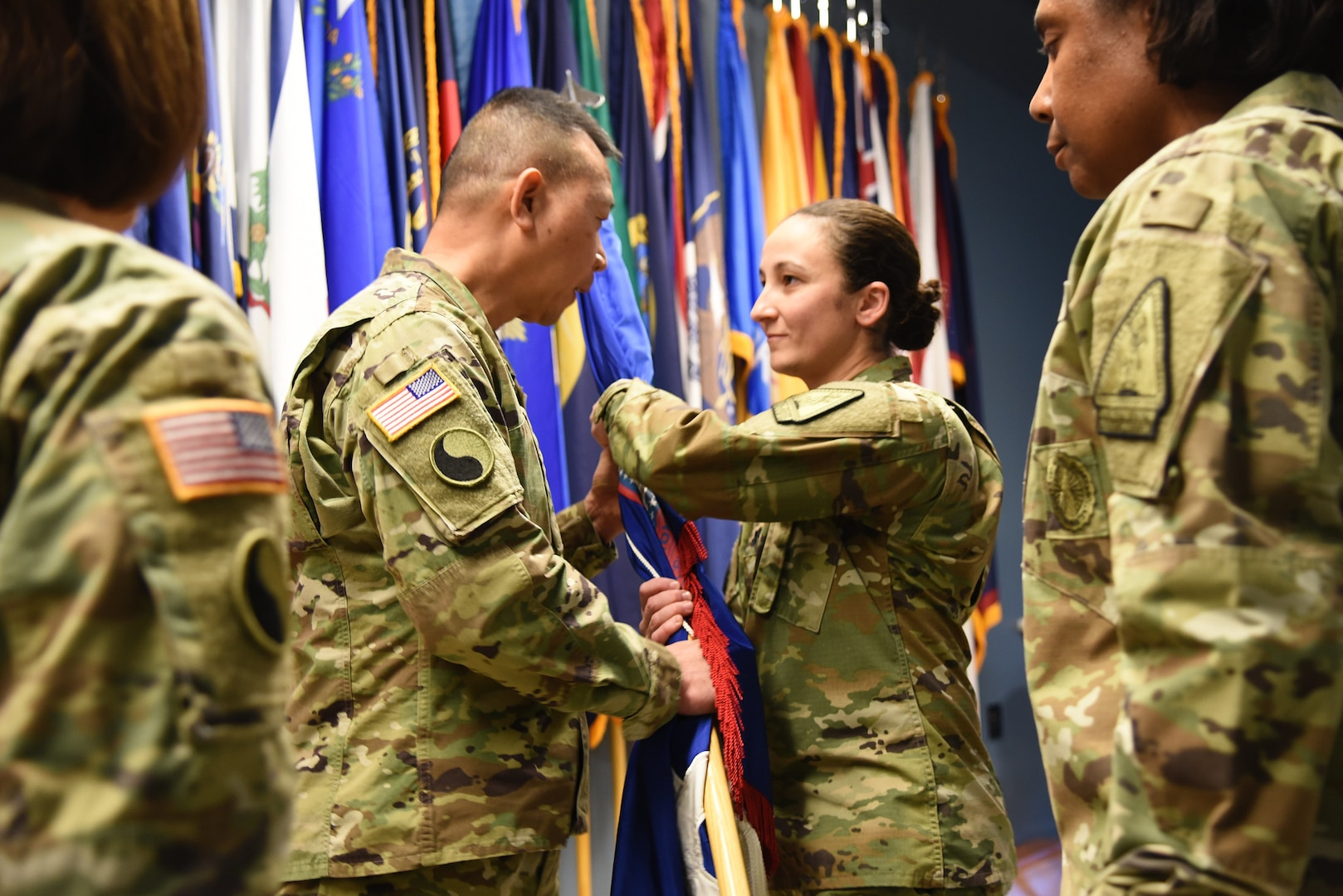 Lt. Col. Alyssa Astphan takes command of the Virginia National Guard's Recruiting and Retention Battalion from Lt. Col. Jennifer Martin in a change of command ceremony held Dec. 7, 2018, at Fort Pickett, Virginia. Brig. Gen. Lapthe Flora, Virginia National Guard Assistant Adjutant General - Army, presided over the exchange of the guidon that represented the transfer of command from Martin to Astphan. (U.S. Army National Guard photo by Sgt. 1st Class Terra C. Gatti)