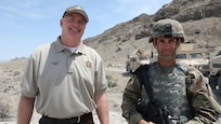 Chief Justin J. Shirley, Chief of law enforcement for the Utah Department of Wildlife Resources, and Sgt. 1st Class Dennis Shumway with the 118th Transportation Company of the 204th Maneuver Enhancement Brigade, participate in an interview at Dugway Proving Ground, Utah, June 16, 2021.