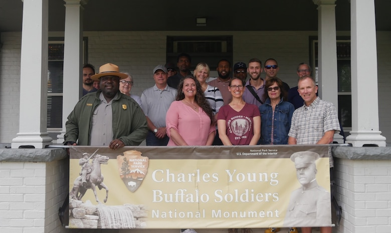 Robert Stewart, Superintendent of the Charles Young Buffalo Soldiers National Monument (front row, far left), poses in front of Young's home with the AFRL tour group. The tour was a special going-away gift for Col. Michael Warner, (front row, far right). (U.S. Air Force photo/Spencer Deer)