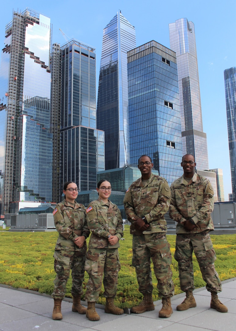 New York Army National Guard Spcs. Armani and Artez Wilkins, right, and Pfcs. Jiralmi and Gizelle Lugo, left, on the roof of the Jacob Javits mass vaccination site  in New York June 29, 2021. The two sets of identical twins have served together to support New York's Operation COVID-19 response.