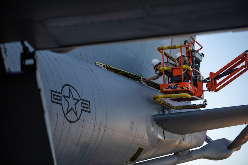 U.S. Airmen from the 151st Air Refueling Wing, Utah Air National Guard and 190th Air Refueling Wing, Kansas Air National Guard, remove the tail from a KC135R at Roland R. Wright Air National Guard Base, Utah, June 2, 2021.