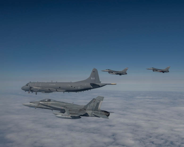 Royal Canadian Air Force CF-18 fighters from the 433 Tactical Fighter Squadron, 3 Wing, Bagotville, U.S. Air Force F-16 fighters from the 140th Wing, Colorado Air National Guard, and an Royal Canadian Air Force CP-140 Long Range Patrol aircraft from 14 Wing, Greenwood, Nova Scotia, conduct a mission over the Northeast corner of Newfoundland and Labrador during the Exercise Amalgam Dart on the Monday June 14, 2021.