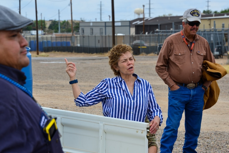 Lady explains spill prevention protocol to a small group of people at Kirtland, AFB.