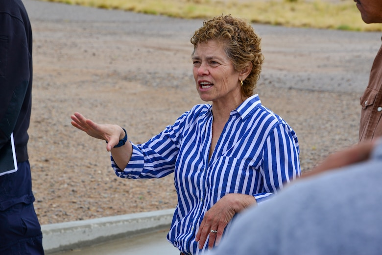 Lady explaining spill prevention to a small group of people at Kirtland, AFB.