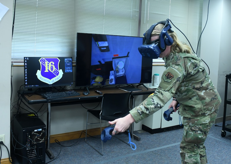 Woman in Air Force uniform wears virtual reality headset while training