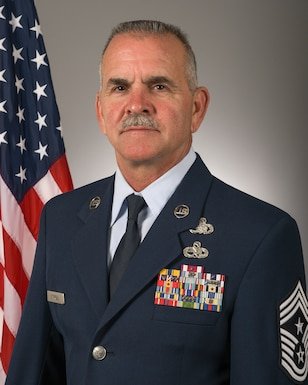 Command Chief Master Sgt. Brian Carroll poses for an official portrait June 29, 2021 in the 115th Fighter Wing public affairs studio at Truax Field, Madison, Wisconsin. (U.S. Air National Guard photo by Master Sgt. Paul Gorman)