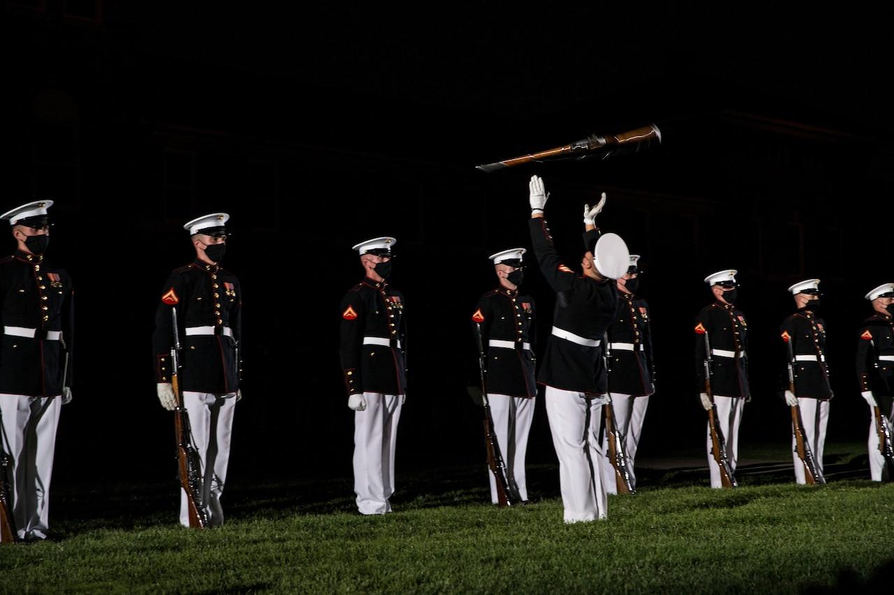 Marine Corps Silent Drill Platoon perform in the dark.