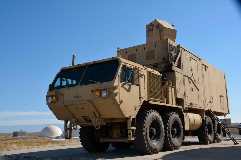 Truck sits in a desert.