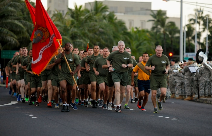 U.S. Marine Corps Lt. Gen. John A. Toolan, commander, U.S. Marine Corps Forces, Pacific, and Sgt. Maj. Paul G. McKenna, force sergeant major, lead a formation with Marines from U.S. Marine Corps Forces, Pacific and Marine Corps Base Hawaii in the Great Aloha Run in Honolulu, Hawaii, Feb. 15, 2016.