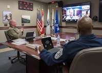 Chief Master Sgt. of the Air Force, Chief Master Sgt. Kaleth O. Wright, speaks with U.S. Marine Corps Sgt. Maj. Paul G. McKenna, North American Aerospace Defense Command and U.S. Northern Command Senior Enlisted Leader, at the commands' headquarters, April 18, in Colorado Springs, Colorado.