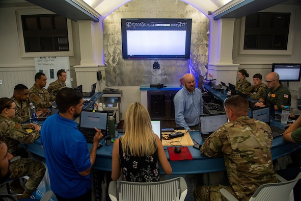 Airmen from Joint Base Charleston's innovation lab, Palmetto Spark, learn about robitic process automation (RPA) at Joint base Charleston, S.C., June 22, 2021.