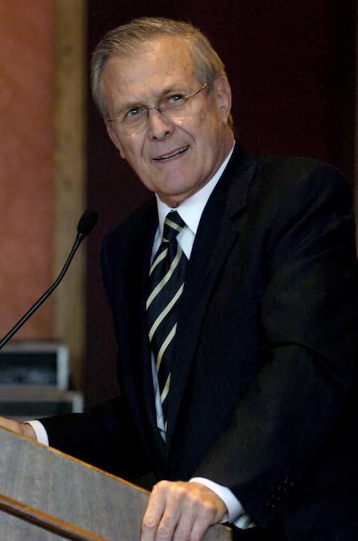 Defense Secretary Donald H. Rumsfeld stands at a lectern.