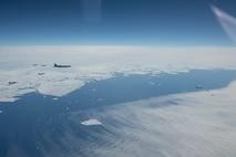 Royal Canadian Air Force CF-18 Hornet, United States Air Force F-16 Fighting Falcon, and United States Air Force F-22 Raptor fight jets fly in formation with two United States Air Force B-52 Stratofortress over Alaska, during Exercise Amalgam Dart 21-1, June 15, 2021.