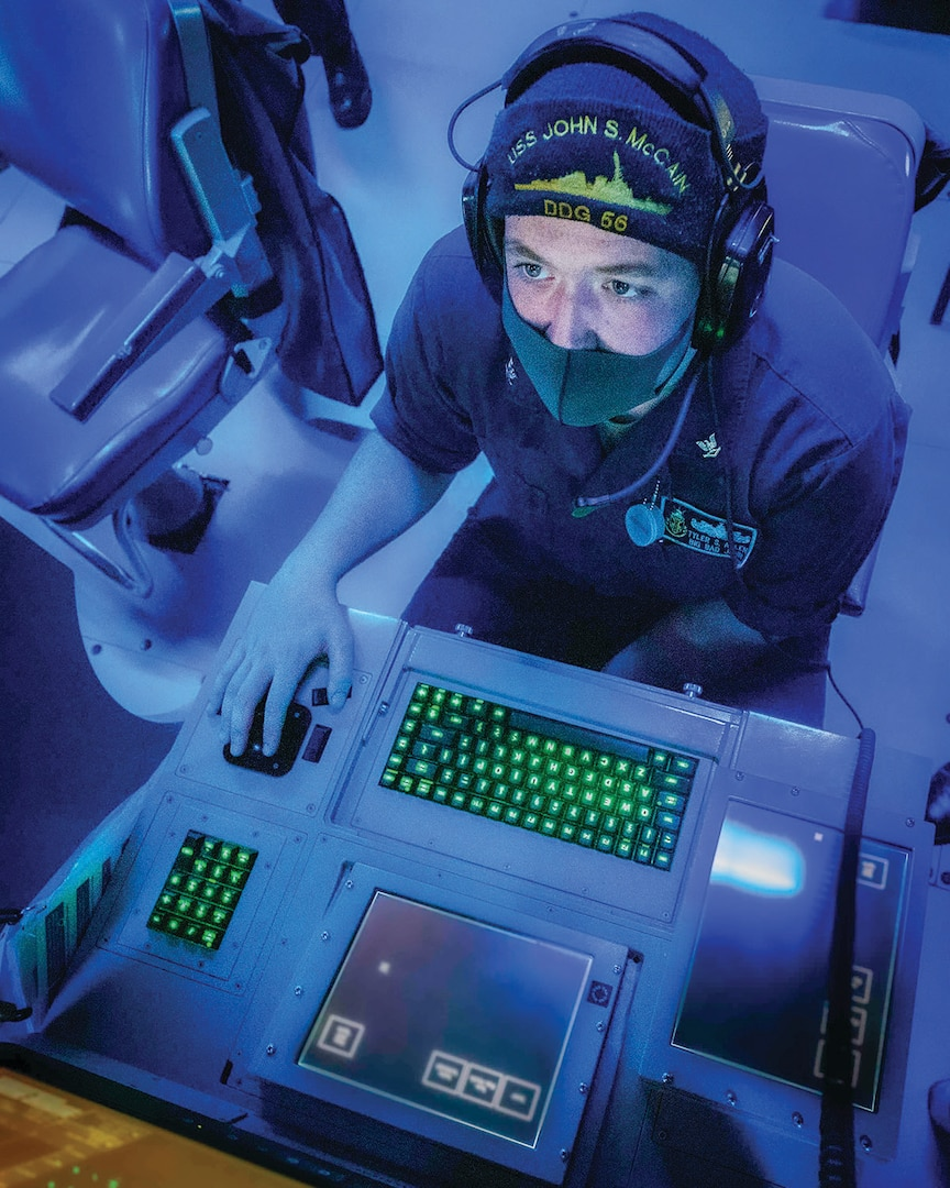 Sailor monitors subsurface contacts while standing watch in sonar control room aboard Arleigh Burke–class guided-missile destroyer USS John S. McCain during target-tracking training evolution as part of Malabar 2020, Indian Ocean, November 3, 2020 (U.S. Navy/Markus Castaneda)