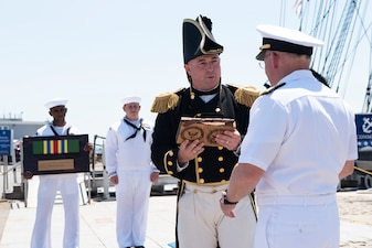 BOSTON (June 30, 2021) - Chief of Naval Operations (CNO) Adm. Mike Gilday presents the Meritorious Unit Commendation to the crew of USS Constitution. The crew earned the award for their success in adapting to virtual tours after the pandemic began in 2020. Constitution Sailors conducted tours for more than 4.5 million people and brought the Navy's history to quarantined Americans in all 50 states and 24 other countries. (U.S. Navy Photo by Mass Communication Specialist 1st Class Raymond D. Diaz III/Released)