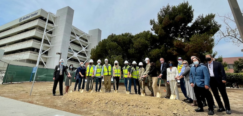 Representatives of the U.S. Army Corps of Engineers, the Department of Veterans Affairs, the Paralyzed Veterans of America and contractors gather June 16, 2021, at the San Diego Veterans Affairs Medical Center campus to break ground on the new Spinal Cord Injury/Community Living Center.