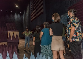Amarachi Egbuziem-Ciolkosz, an engineer with the 772nd Test Squadron, 412th Electronic Warfare Group, provides a tour of the Benefield Anechoic Facility during the 412th EWG Family Day at Edwards Air Force Base, California, June 18. (Air Force photo by Bryce Bennett)