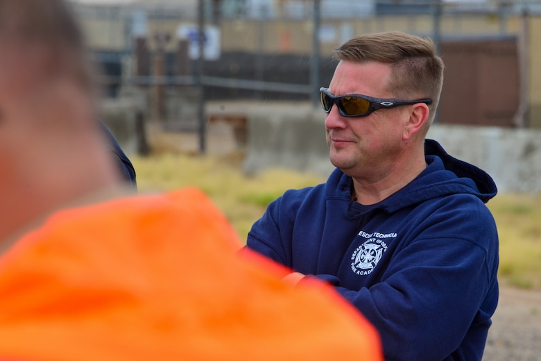 Man listens to a spill prevention protocol explanation at Kirtland, AFB.