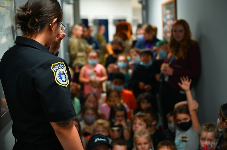 Nikki McManigal, a security forces leader assigned to the 28th Security Forces Squadron, answers questions from children of the Ellsworth School Age Care program during a visit on Ellsworth Air Force Base, S.D., June 25, 2021