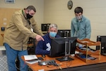 (From left to right) NNSY Operations Department's (Code 300) Scheduler Roger Behm, Assistant Project Superintendent Mark Meidel and MSE Deputy Kyle Alexander testing the new MSE program.