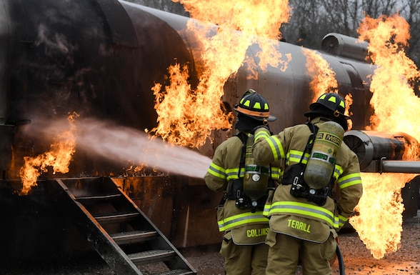 Arnold Air Force Base Fire and Emergency Services personnel battle a fuselage fire as they train, Feb. 9, 2021, on aircraft rescue and firefighting techniques at Arnold AFB, Tenn. The firefighters attacked the fire first with vehicle-mounted nozzles, then hand lines on the external blazes, before making entry into the aircraft. (U.S. Air Force photo by Jill Pickett)