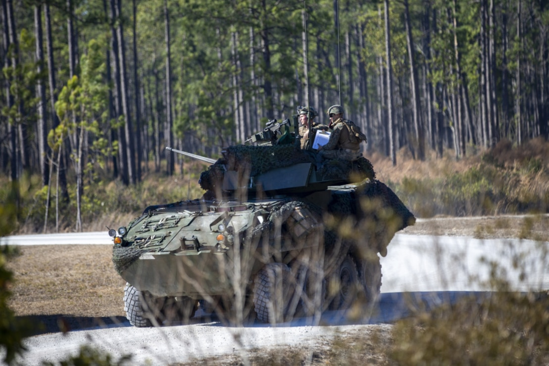 U.S. Marines with 2d Light Armored Reconnaissance Battalion, 2d Marine Division, prepare to fire an M242 Bushmaster weapon system during a semiannual gunnery qualification range on Camp Lejeune, N.C., Feb. 24, 2021. The qualification range tests the Marines decision making process by evaluating a wide variety of scenarios to eliminate enemy targets, as well as maintain combat lethality and readiness. (U.S. Marine Corps photo by Pfc. Sarah Hediger)