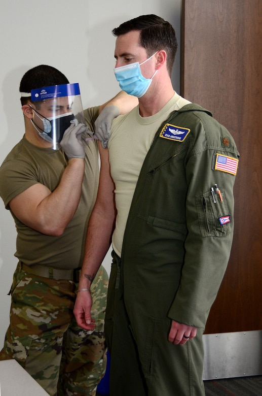 Maj. Ryan Armstrong, 89th Airlift Squadron C-17 pilot, receives his first COVID-19 vaccination Feb. 26, 2021. The 445th Aerospace Medicine Squadron administered the vaccination to 445th Airlift Wing reservists and monitored each Airman for development of side effects. The two-dose vaccine was recently approved by the Food and Drug Administration under an emergency use authorization and are currently offered to Defense Department personnel on a voluntary basis. (U.S. Air Force photo/Mr. Darrell Sydnor)