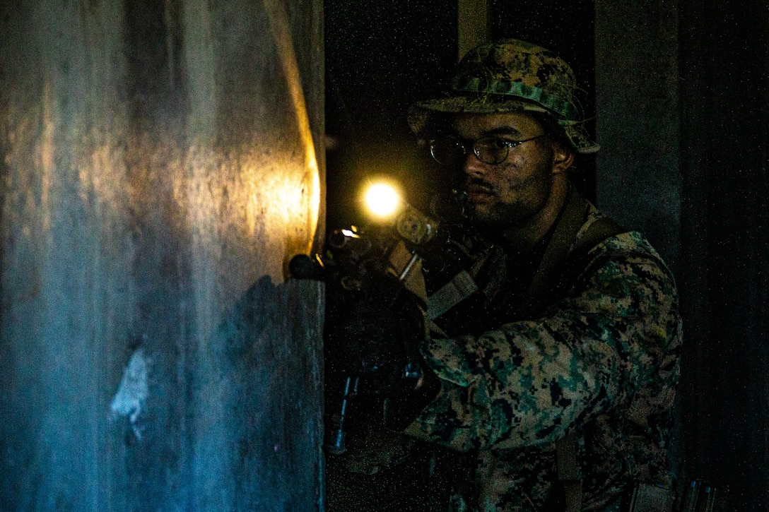 A U.S. Marine clears a room during military operations on urban terrain training as part of Exercise Bougainville I at Marine Corps Training Area Bellows, Hawaii, Feb. 11.